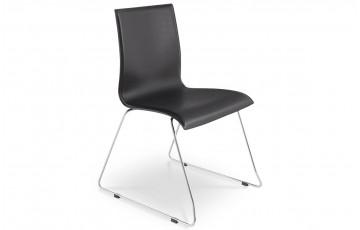 Chaise design noire KYRA en simili cuir