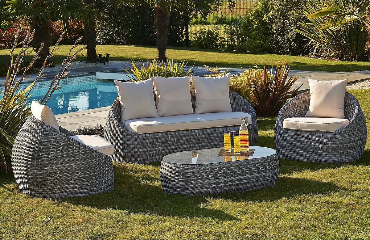 Salon de jardin avec une table et 4 fauteuils assortis