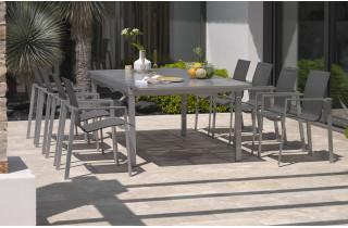 Ensemble table rallonge papillon 8-10 places aluminium gris galet + 8 fauteuils assortis